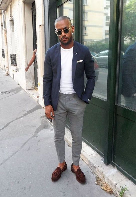 a casual summer work look with a white tee, a navy blazer, grey pants, brown loafers