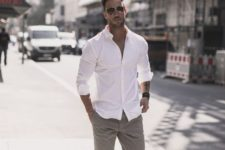a casual summer work outfit with a white shirt with rolled up sleeves, grey rolled up pants, white sneakers