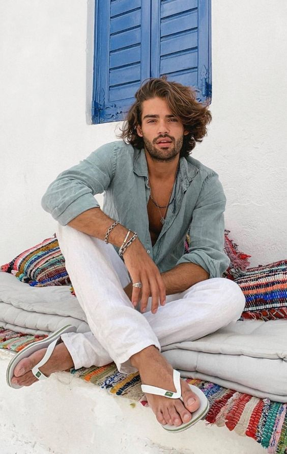 a chambray shirt and white linen pants plus white flipflops for a relaxed summer outfit