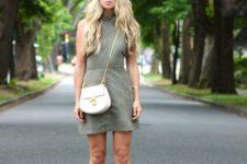 a grene halter neckline mini dress, a white crossbody bag, neutral heels for a summer party