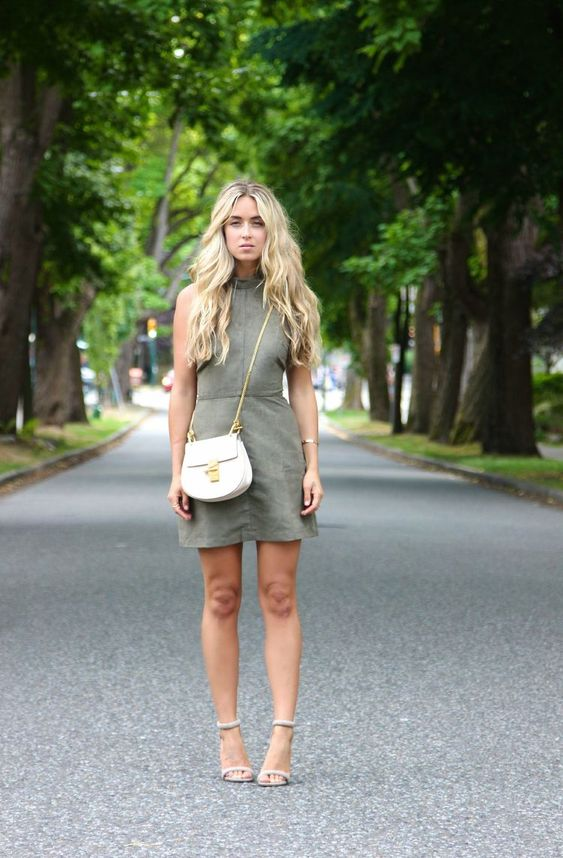 a grene halter neckline mini dress, a white crossbody bag, neutral heels for a summer party