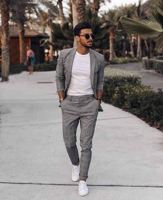 a grey checked suit, a white tee and white sneakers for a casual busuiness summer look