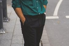 a hunter green shirt, black pants, white sneakers for a casual summer work look