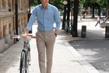 a simple look with a light blue shirt, grey pants and brown suede moccasins for summer
