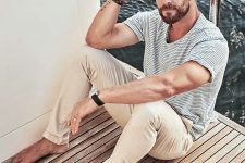 a striped blue tee, tan pants are a perfect combo for your relaxed seaside holiday