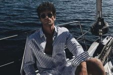 a striped white and navy long sleeve shirt and white linen shorts to avoid overheating