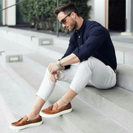 a stylish work look with neutral pants, a navy shirt, brown moccasins for every day