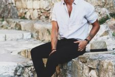 a white linen shirt, black pants, black slippers for a stylish monochromatic summer look