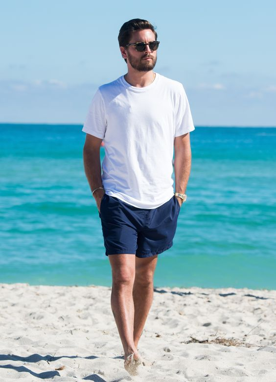 a white oversized tee, navy shorts are all you need to feel comfortable by the seaside