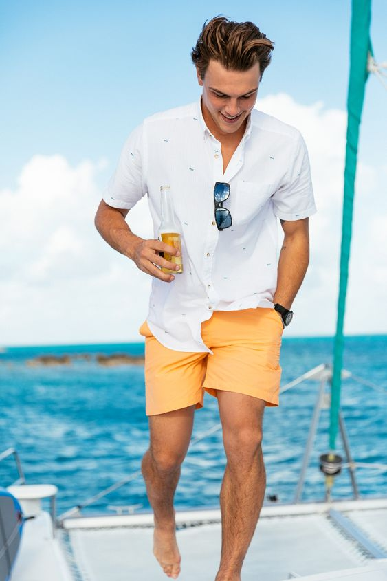 a white printed shirt with short sleeves and pockets and sunny yellow shorts for a simple and lovely summer look