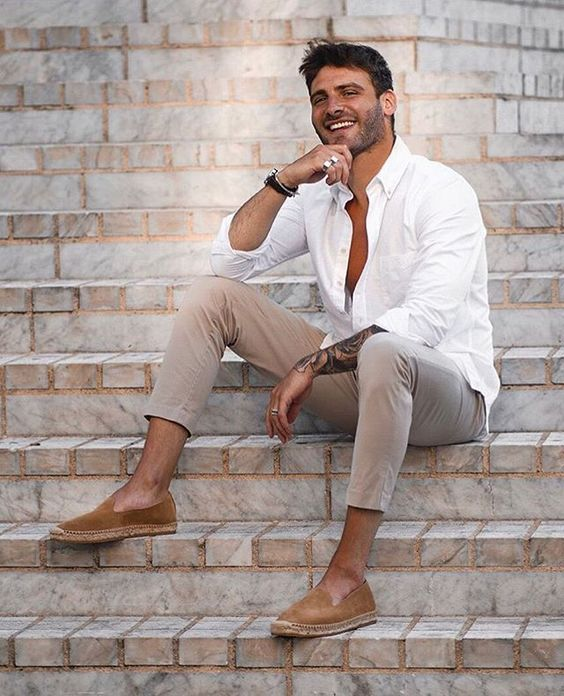 a white shirt, grey pants and brown espadrilles are a perfect summer or holiday combo