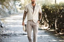 a white short sleeve shirt, striped pants, brown shoes and a hat for a wow summer look