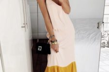 an informal party look with a cool blush and mustard maxi dress, yellow and white sneakers, a white hat and a black bag