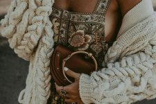 a boho printed floral dress on straps, a brown bag with a round handle and a neutral cardigan for cold days