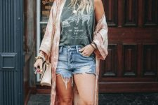 a printed sleeveless top, denim shorts, tan booties, a tie dye coverup, a hat and a neutral bag