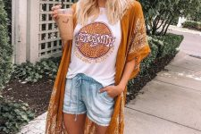 a printed tee, denim shorts, a mustard printed kimono and a necklace for a summer boho look
