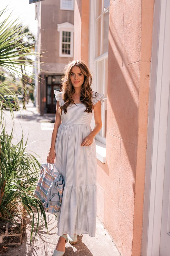 a blue and white vintage inspired maxi dress with ruffle cap sleeves, a square neckline, a tote and espadrilles