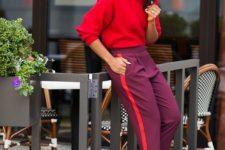 a colorful look with a hot pink sweatshirt, purple side stripe pants, nude heels