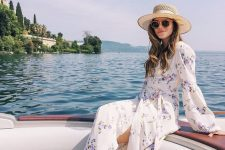 a floral wrap maxi dress with long sleeves, woven flats with lacing up and a hat for summer