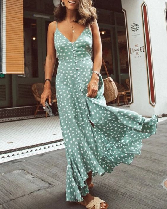 a green and white polka dot maxi sundress with buttons, woven slippers and a wicker bag for a hot day