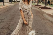a neutral plaid wrap maxi dress with pockets, white sneakers and a white bag for an everyday look