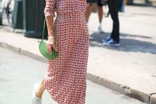 a red and white printed maxi dress, a green bag and white sneakers to look bright in summer