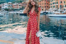 a red wrap maxi dress, a small catchy bag and tan heels for a romantic and chic summer look
