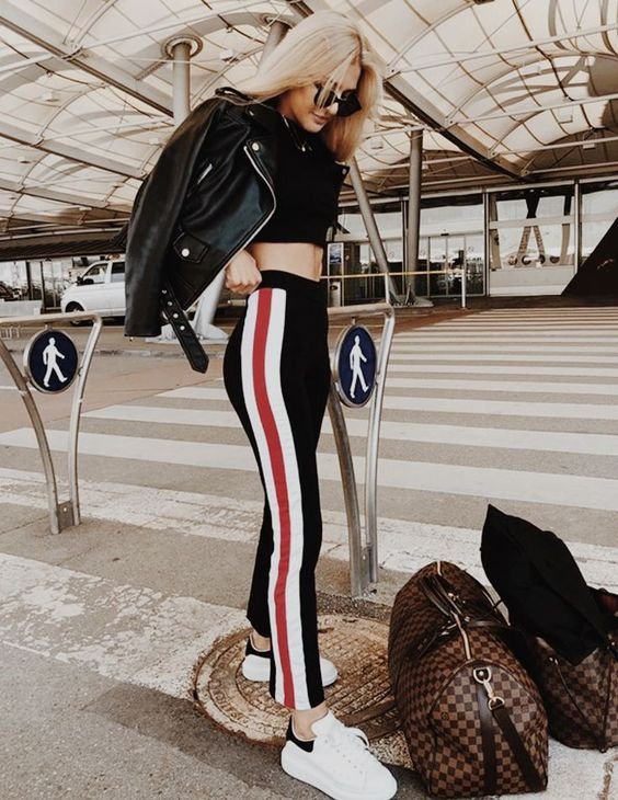 a sexy outfit with a black crop top, black side stripe pants, white sneakers, a black leather jacket