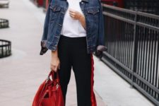 a simple and stylish look with a white tee, black side stripe pants, white sneakers, a blue denim jacket and a red bag
