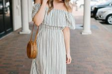 a simple striped off the shoulder A-line maxi dress, brown leather slippers and a brown woven bag