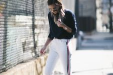 a sporty outfit with a navy sweatshirt, white side stripe pants, white sneakers to wear every day