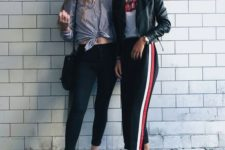 a stylish outfit with a white printed tee, black side stripe pants, black sneakers and white socks and a black leather jacket