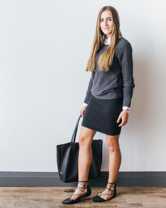 a black pencil skirt, a grey sweater with a shirt underneath, black lace up flats and a black tote