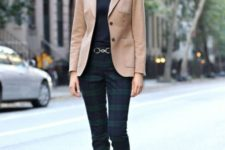 a black top, checked pants, a camel blazer, black and gold flats plus a statement necklace