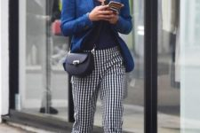 a bold outfit with a navy top, a bright blue blazer, cobalt blue flats and checked pants plus a black bag