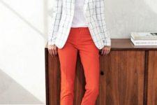 a white top, orange cropped pants, a white windowpane blazer, black silngback flats