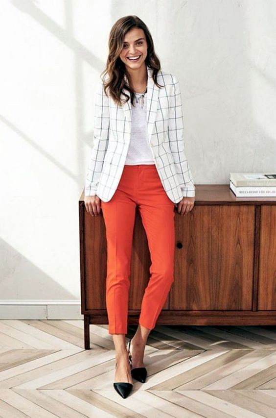 a white top, orange cropped pants, a white windowpane blazer, black silngback flats