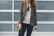 an off-white sweater, navy skinnies, oxblood strappy flats and a checked blazer plus a camel bag
