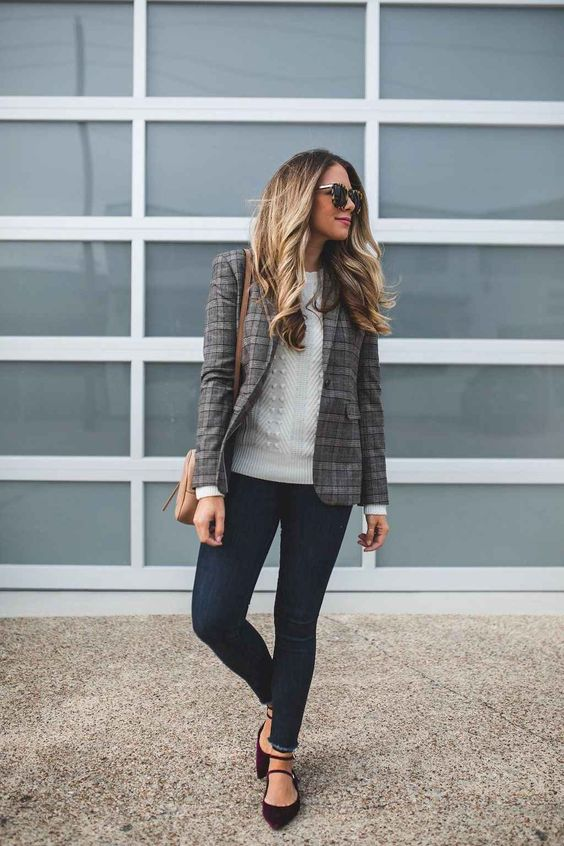 an off white sweater, navy skinnies, oxblood strappy flats and a checked blazer plus a camel bag