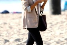 black skinnies, a neutrla top, a neutral blazer, black flats and a black bag make up a casual work outfit