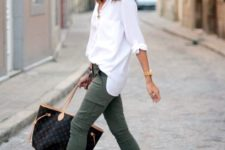olive green cargo pants, a white button down, red flats and a printed bag