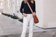 a black top, white raw hem jeans, black slipper mules and a brown crossbody bag