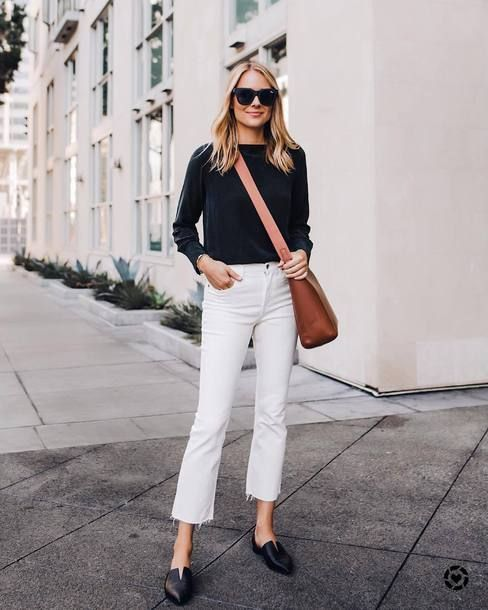 a black top, white raw hem jeans, black slipper mules and a brown crossbody bag