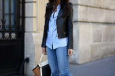 a blue shirt, blue cropped skinnies, black ankle booties, a cropped black leather jacket and a two-tone bag