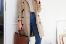 a neutral top, blue mom jeans, white sneakers, a nuetral classic trench and a brown tote