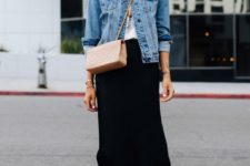 a printed tee, a denim jacket, a black midi skirt, tan trainers and a matching crossbody bag