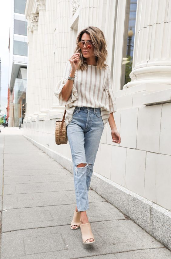 a striped shirt, blue ripped skinnies, nude mules and a wicker round bag for s spring to summer look