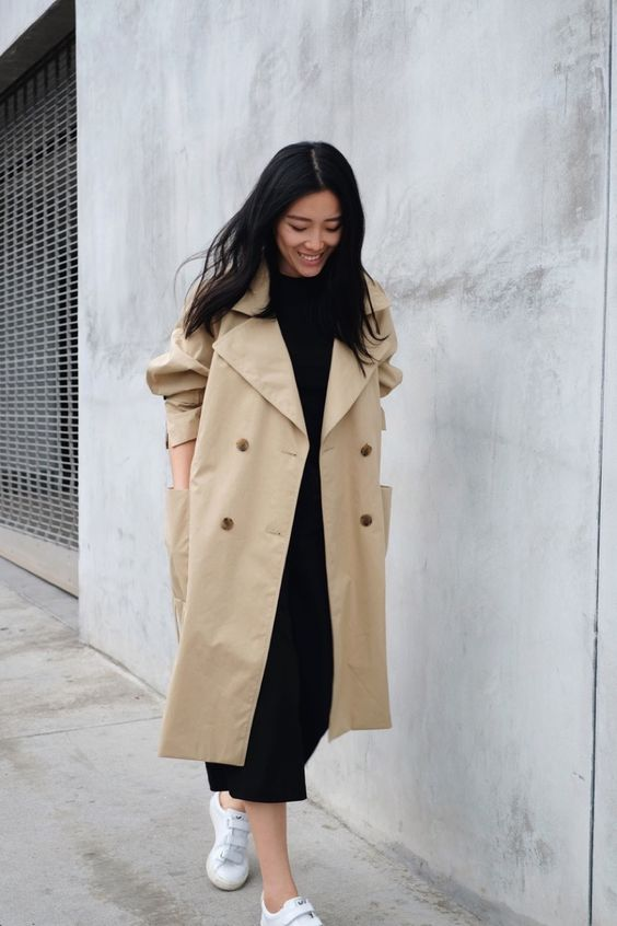 a tan oversized double-breasted trench with bold buttons and large pockets for spring