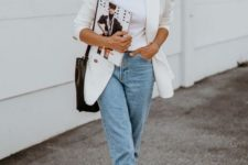 a white top, a white oversized blazer, light blue cropped jeans, printed shoes and a black bag