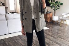 an oversized printed blazer, a white top, black skinnies and black moccasins